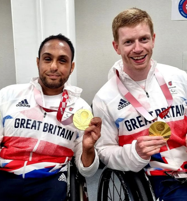 Ayaz Bhuta and Jim Roberts posing with medals